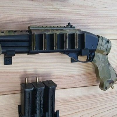 Wall mount or cabinet for Shotguns.